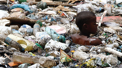 The Brazilian Slum Children Who Are Literally Swimming in Garbage