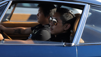 Driving Ferraris with Thai Royalists