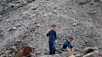 Meet the Children and Pregnant Women Carrying Rocks All Day for Albania's Mining Pirates