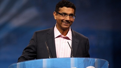 Convicted Felon Dinesh D'Souza Is Still Hustling Old White People