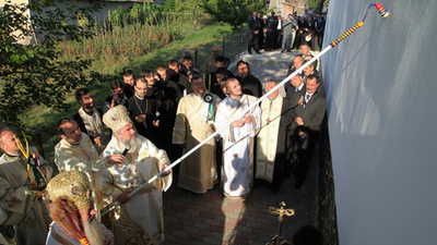 This Romanian Priest Blesses Stuff with His Long, Extendable Rod