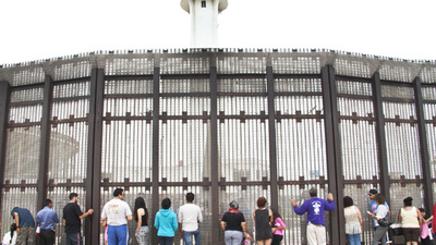 Talking to Deported Immigrants Through the Fence at the US-Mexico Border