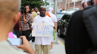 Why Did Police Arrest This Man In Front of His Kids at Eric Garner's Funeral?
