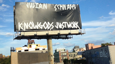 The Story Behind Those Cryptic Billboard Messages All Over New York City