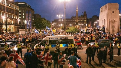 Why Were Two Scottish Independence Supporters Arrested for Their Peaceful Stand in Glasgow?