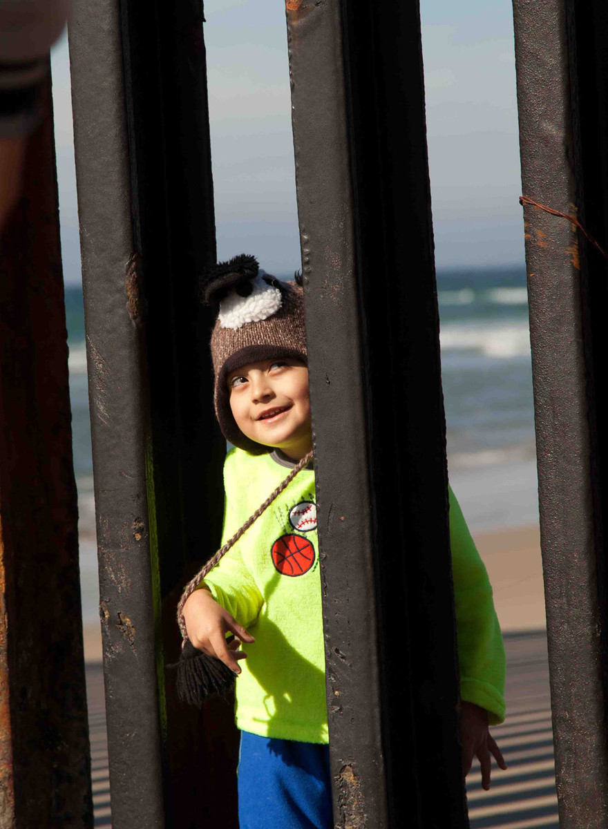 Photos of Kids Playfully Crossing the US-Mexico Border
