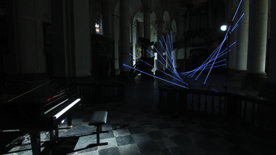 Glowing Cables Transform a Cathedral into a Massive Player Piano
