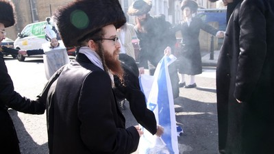 Ultra-Orthodox Anti-Zionist Jews Held an Israeli Flag Burning Protest in London Yesterday