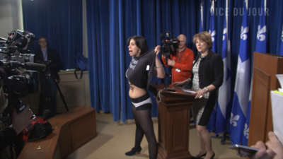 Topless Feminist Who Hijacked Quebec Minister's Press Conference Declares Victory