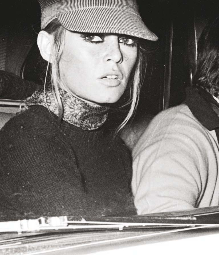 Brigitte Bardot—perhaps trying to be incognito in her hat—on September 1, 1968, at the Zoom Zoom Club in Saint-Tropez, France.