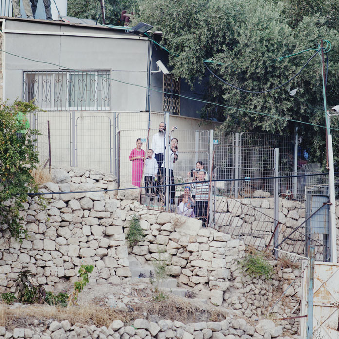 Israeli settlers in East Jerusalem watch a demonstration, 2010.