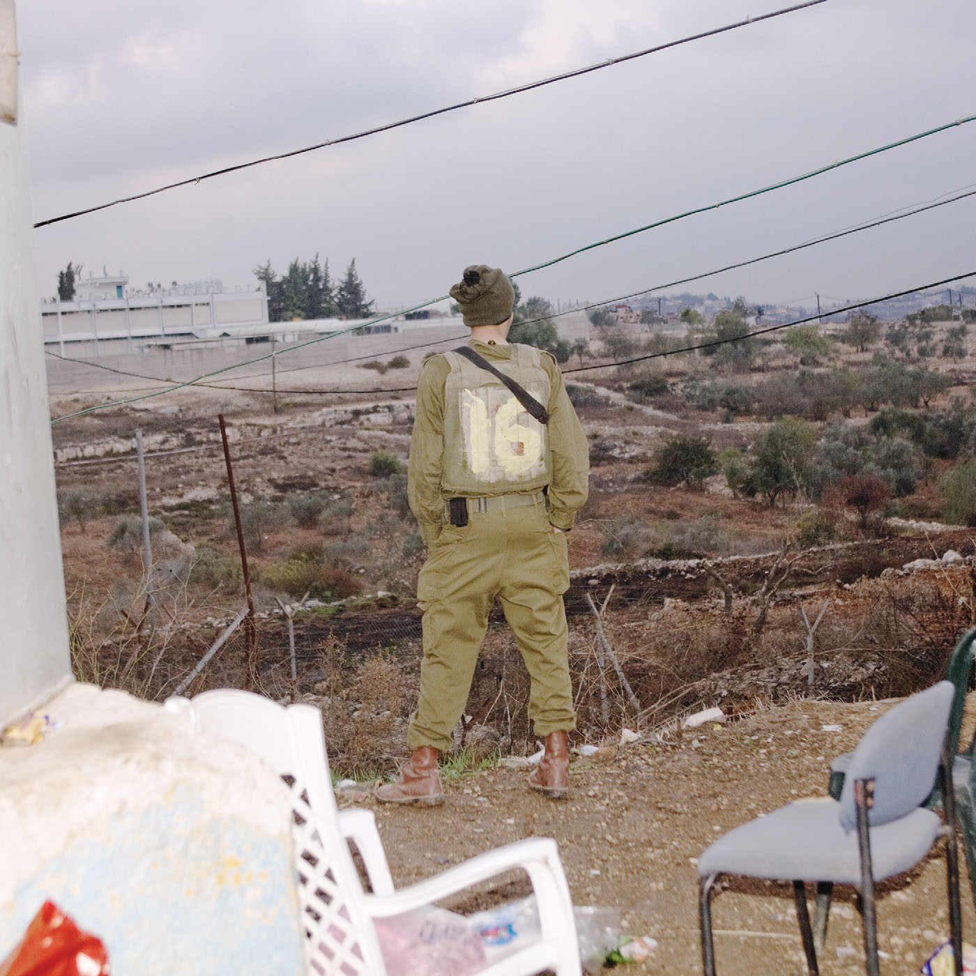 A young man looks out over Beit El, an Israeli settlement on the West Bank, 2008.