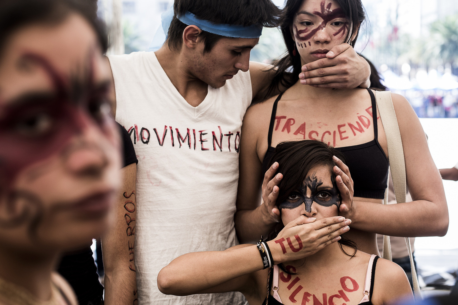 "A dance troop practices wearing body pant that says out, ""Our movement transcends your silence."""