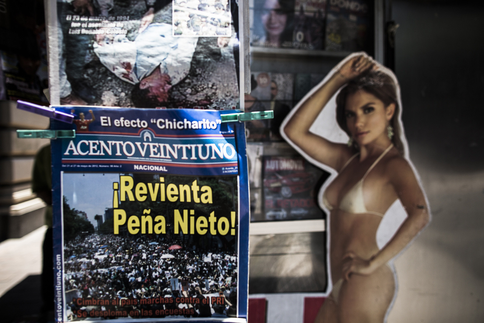 A newspaper showing one of the many daily-dead is sold next to one of the few magazines covering the movement at a newsstand in Mexico City.