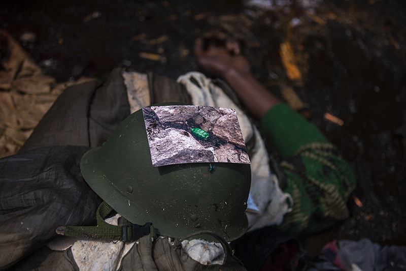 The photographic print of a grenade on the helmet of a slain FARDC soldier.