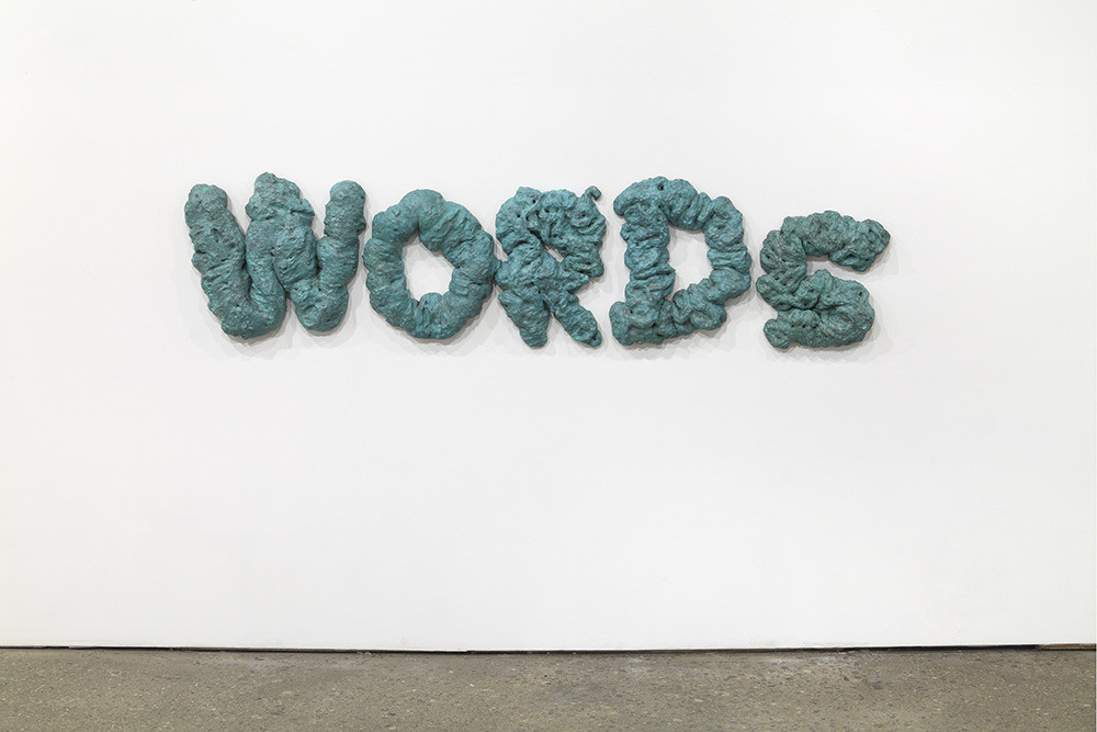 David Shrigley, Words (1), 2012, Bronze and patina, 15 x 63 x 2 1/2 inches, Courtesy Anton Kern Gallery, New York