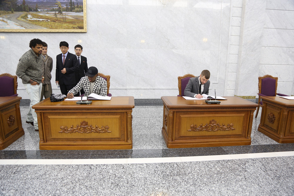 Ryan Duffy and Dennis Rodman sign the guest book after their visit to Kumsusan Palace, where Kim Il Sung and Kim Jong Il's bodies lie in state.