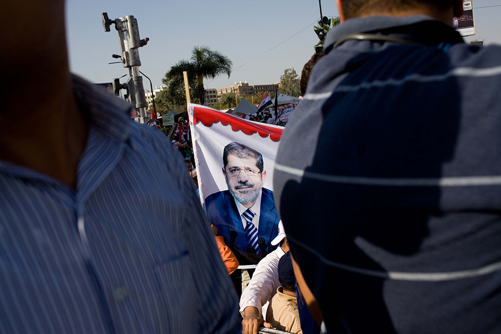 Tens of thousands of Muslim Brotherhood supporters gather outside Rabaa Al-Adawiya mosque in Nasr City on June 28 to show their support for President Morsi.