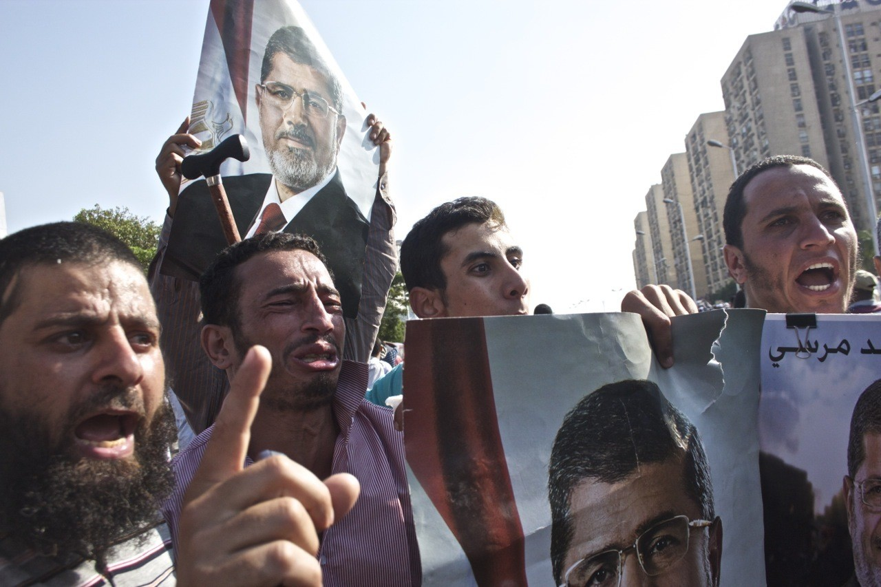 Men chant in support of former President Morsi.