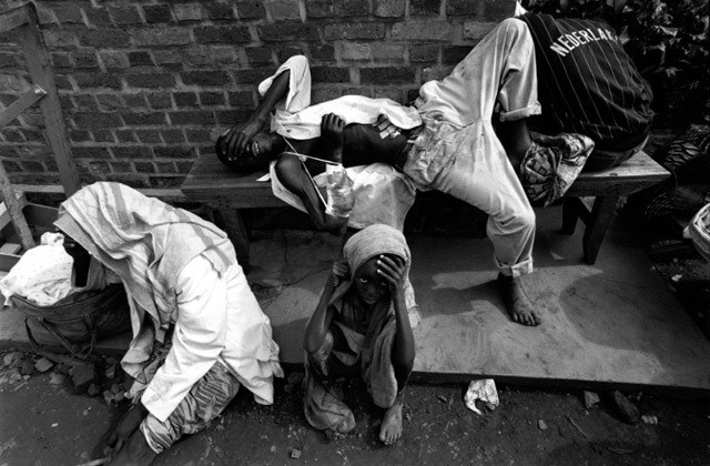 Injured Tutsies take refuge outside a school in Ruhengeri, Rwanada 1994.
