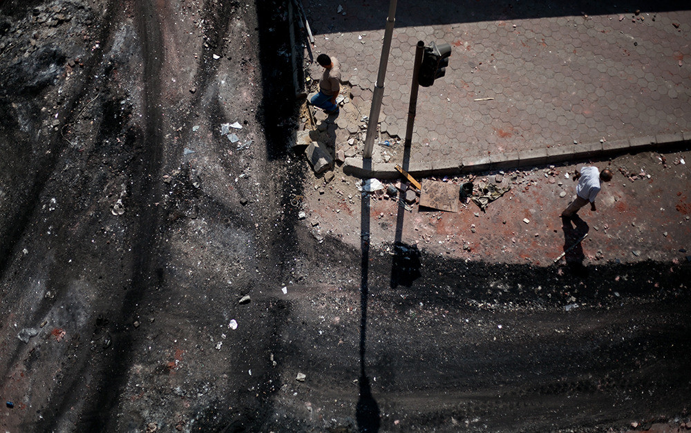 A day after the sit ins were cleared. Debris still remains from clashes can be seen throughout neighborhoods in Cairo.